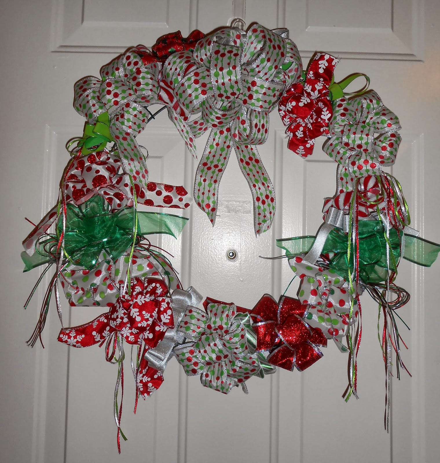 i really wanted to do a christmas wreath this year and was inspired to do it with lots of colorful ribbons there was so much ribbon on sale at michaels - Michaels Christmas Wreaths